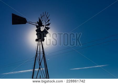 Wind Pump Windmill Silhouette In The Karoo Desert Of South Africa
