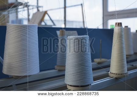Big Spools With White Thread For Rewinding At Knitting Shop View