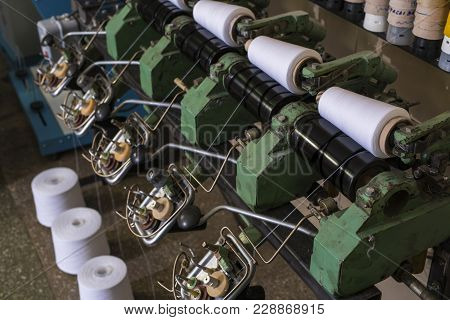 Big White Thread Spools At Rewinding Machine At Knitting Shop View