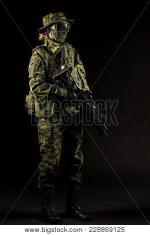 Portrait Of Armed Woman With Camouflage. Young Female Airsoft Sniper Observe With Firearm. Soldier W
