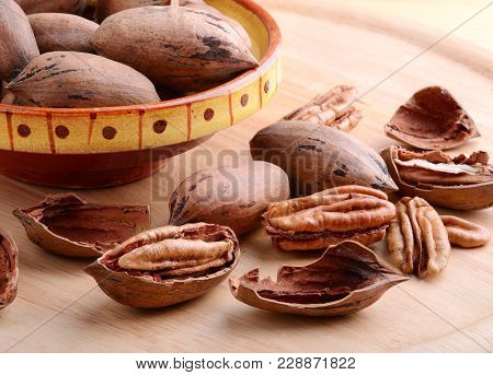 Pecan Nuts Close Up On A Wooden Background