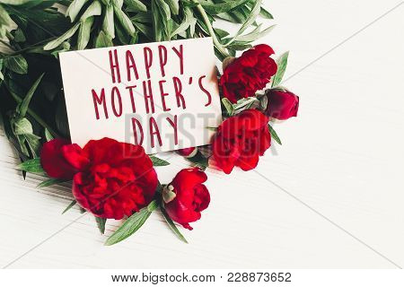 Happy Mother's Day Text Sign On Craft Paper Card Beautiful Red Peonies On White Wooden Rustic Backgr