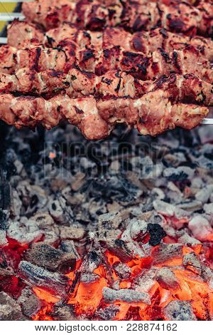 Grilled Meat On Skewers On The Brazier. Roasted Meat Cooked At Barbecue. Bbq Fresh Beef Meat Chop Sl