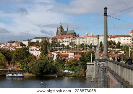 Prague; Czech Republic - October, 6, 2017: Prague castle one of the famous landmarks of the city seen from the Manes Bridge in autumn