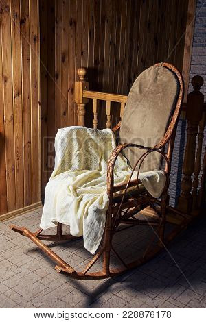 Big Rocking Chair. Wooden Walls. Cozy Place.