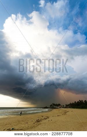 Ahungalla Beach, Sri Lanka, Asia - Enormous Clouds And Backlight During Sunset At The Beach Of Ahung