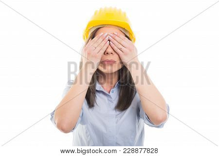 Female Constructor Wearing Hardhat Covering Her Eyes.
