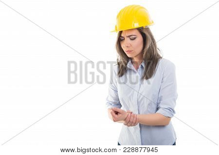 Portrait Of Female Constructor Holding Her Wrist.