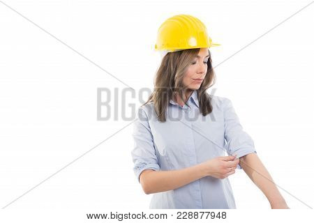Portrait Of Female Constructor Arranging Her Sleeve.