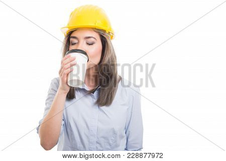 Pretty Female Constructor Drinking Takeaway Coffee.