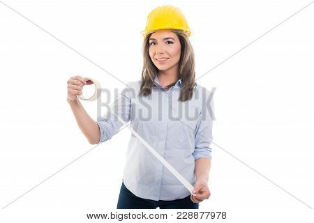 Attractive Female Constructor Holding Paper Tape.