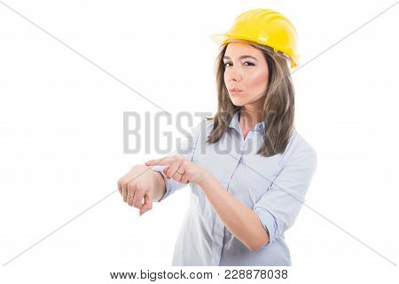 Portrait Of Female Constructor Showing Being Late Gesture.