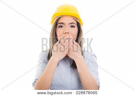 Portrait Of Female Constructor Covering Her Mouth Like Not Speaking.