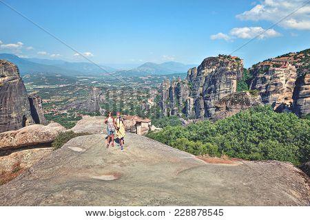 Two Happy Woman Traveler Enjoys  Landscape With  Mountains. Meteora Monasteries, Greece.