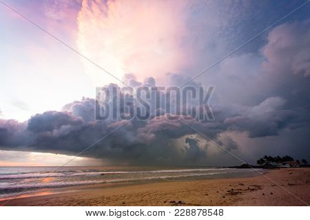 Ahungalla Beach, Sri Lanka, Asia - Illuminated Clouds And Light During Sunset At The Beach Of Ahunga