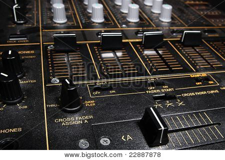 Professional djying equipment in the dark - 4channel club sound mixer poster