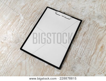 Clipboard With Blank Letterhead On Wood Table Background. Stationery Mockup With Plenty Of Copy Spac