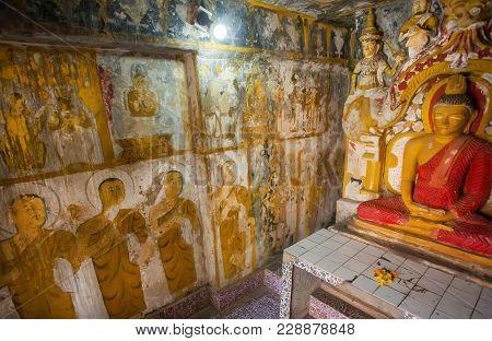 Kandy, Sri Lanka - Jan 5, 2018: Monks On Fresco And Meditating Buddha Statue Inside The 14th Century