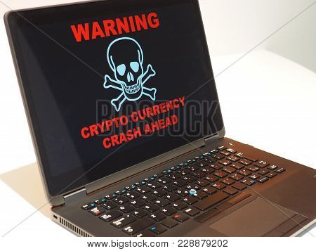 Crypto Currency Crash Alert. Generic Laptop With Large Crypto Currency Alert Warning Across The Scre