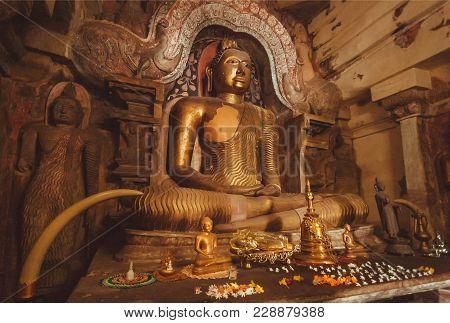 Kandy, Sri Lanka - Jan 5, 2018: Interior Of 14th Century Buddhist Temple With Stone Figure Of Medita