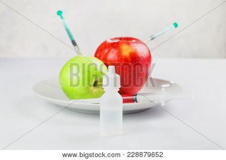 Fresh Juicy Apples On A Plate Processed With Chemicals