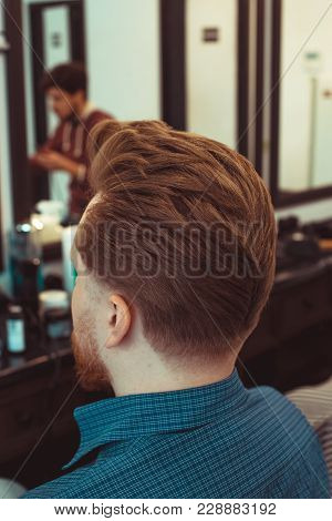 Barber Cutting In Barbershop. Back View Barbershop