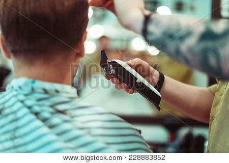Concept Fashion And Beauty, Man S Haircut With Trimmer In Beauty Salon. Focus On The Hair. Soft Focu