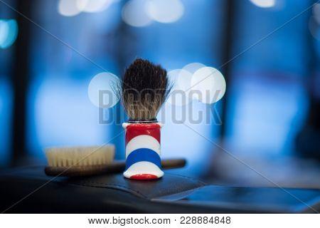 Shaving Brush Shaving Beard On A Blue Blurred Background, Beauty Parlor, Barbershop.