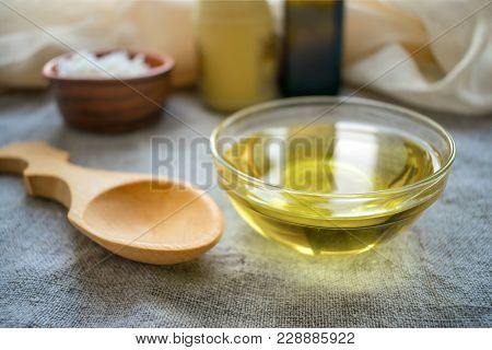 Liquid Coconut Mct Oil In Round Glass Bowl With Wooden Spoon And Bottles. Health Benefits Of Mct Oil