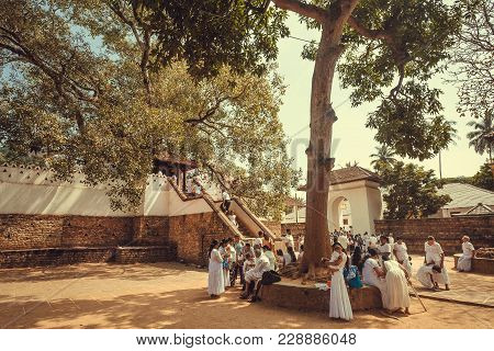 Kandy, Sri Lanka - Jan 5, 2018: Relaxing People Praying Near The Temple Of Sacred Tooth, Unesco Worl