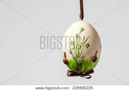Closeup Of A Beautiful Hand Painted Easter Egg Hanging On A Brown String