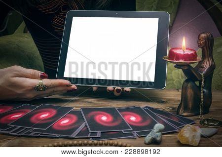 Tarot Cards And Tablet Computer Pad With Blank Screen With Copy Space Template. Online Divination. F