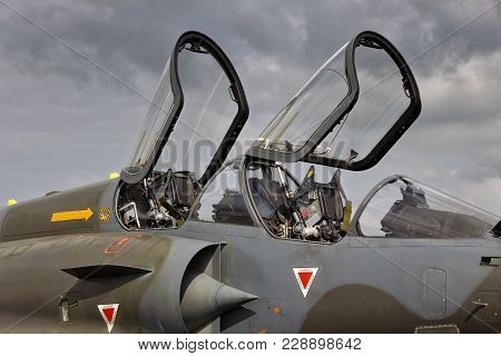 Camouflaged Military Fighter Jet Aircraft Dual Seat Cockpit With Open Canopies.
