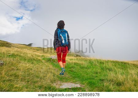 Lonely Girl During An Excursion In The Mountains
