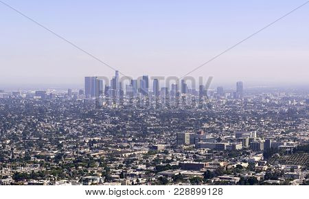 Skyline Of Downtown Los Angeles In A Sunny Summer Day With Clear Blue Sky. Business And Financial Di