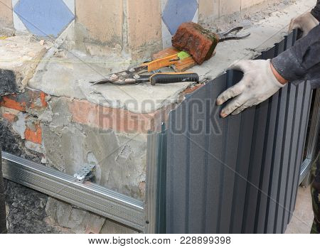 House Foundation Wall Repair And Renovation  With Installing Metal Sheets For Waterproofing And Prot