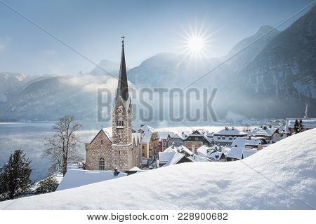 Panoramic View Of Famous Hallstatt Lakeside Town During Winter Sunrise On A Beautiful Cold Sunny Day