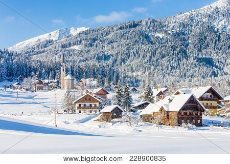 Beautiful Panoramic View Of Historic Gosau Mountain Village On A Scenic Cold Sunny Day With Blue Sky