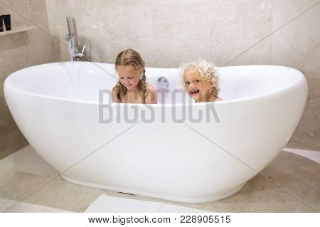 Kids In Bath. Children Bathing. Family Bathroom.