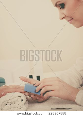 Woman Hand On Towel, Beautician File Nails. Beauty Wellness Spa Treatment, Manicure Concept