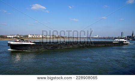 Düsseldorf, Germany - February 28, 2018: Dutch Inland Waterway Motor Freighter Sailing-home On The R