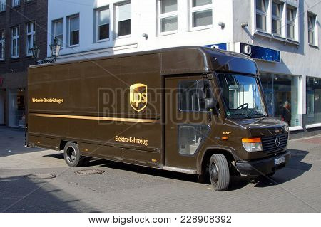 Düsseldorf, Germany - February 28, 2018: Ups Mercedes Electric Delivery Truck Parked By The Side Of
