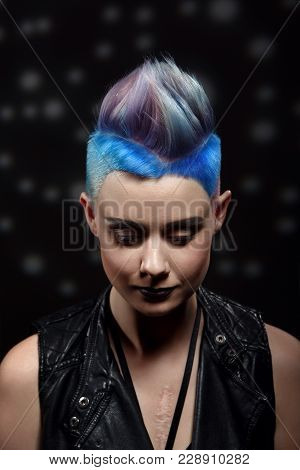 Studio Fashion Creative Model Portrait With Short Colored Blue And Gray Hair And A Scar On The Chest