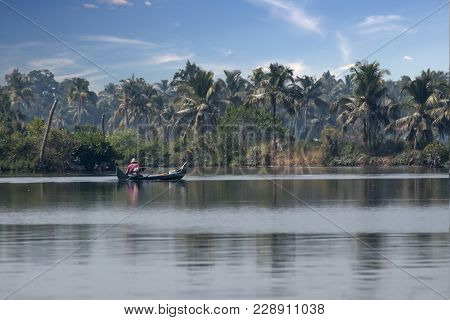 A Common Fishing Style That Is Seen In The River Banks Of Kerala