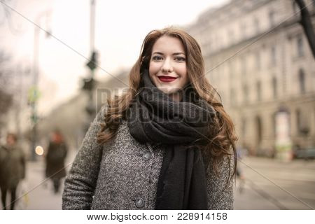 Smiling woman with red lipstick