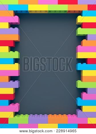 Frame Of Stacked Colorful Toy Bricks On Dark Background