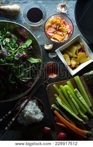 Wok, Rice And Vegetables For Cooking Sushi Top View. Asian Cuisine Vertical