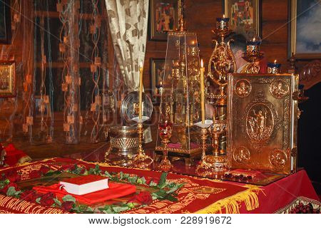 The Throne With The Holy Gospel, Burning Candles, Relics Of The Saints And The Menorah With Burning