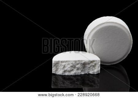 White Pills That Have Expired. On A Black Background