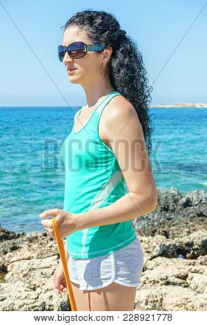 Girl Performs An Exercise With An Expander. Closeup
